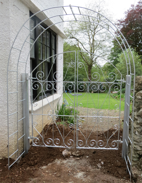 wroughr iron arch with gate