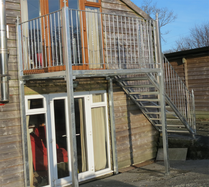 Galvanised steel balcony and steps