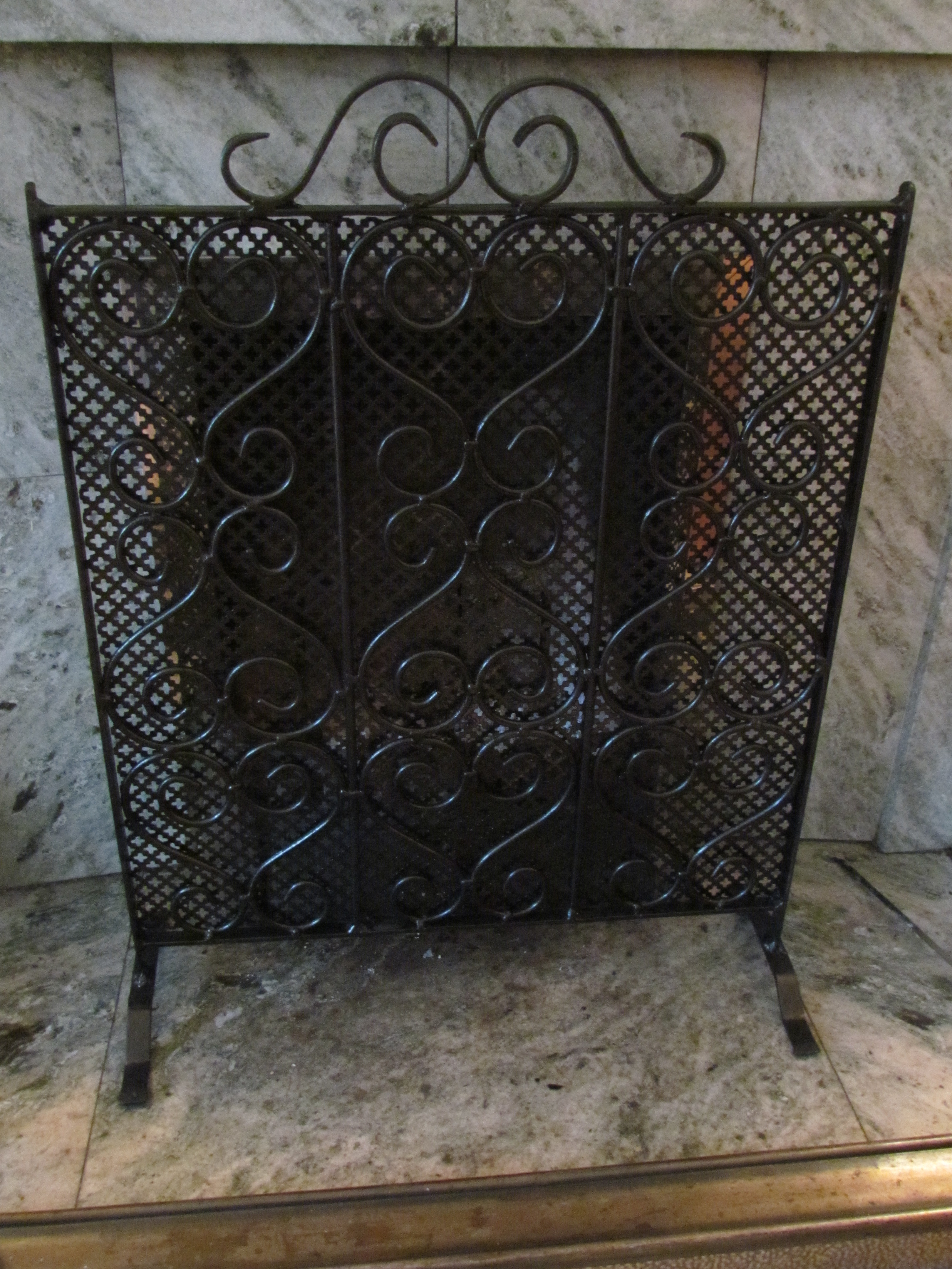 Ornamental wrought iron fire guard