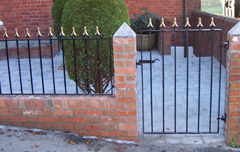 traditional wrought iron garden gate with matching railings